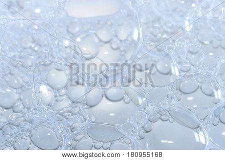 Soap foam bubbles close-up. The texture of foam bubbles. Soap bubbles are round.