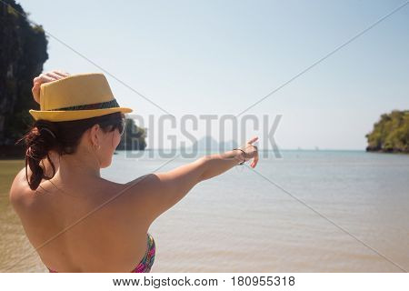 Woman in hat on sea