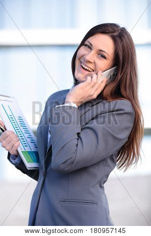 Business woman talking on smart phone . Business people office worker talking on smartphone smiling happy.