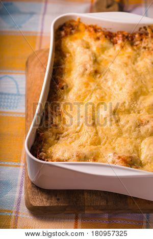 Lasagne cooked at home in large form for baking on stand vertical
