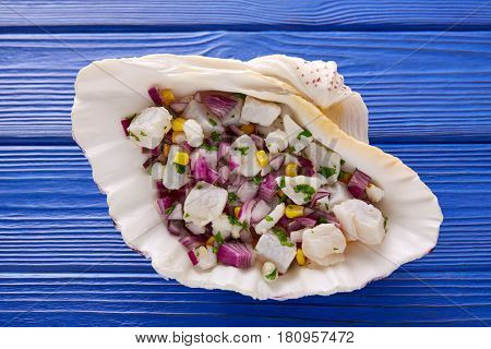 Ceviche peruvian recipe and ingredients on wooden blue table