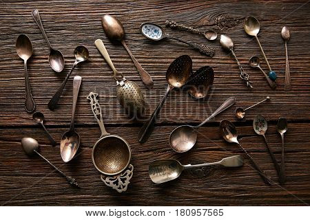 Vintage retro tea spoons and Strainers silver  on wooden background