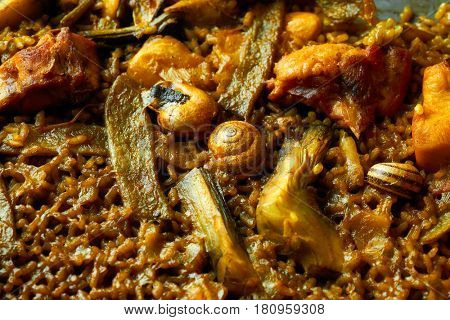 Valencian Paella with chicken rabbit artichokes beans and snails