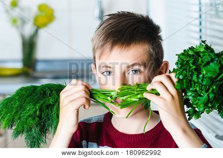 The Child In The Kitchen With Herbs