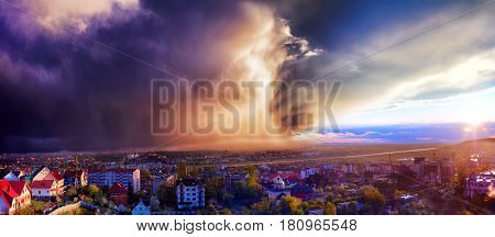 Heavy Rain Approaching On The City At Sunset Light