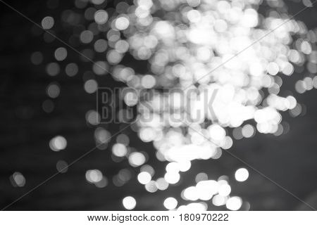Defocused Water Surface With Patches Of Sunlight