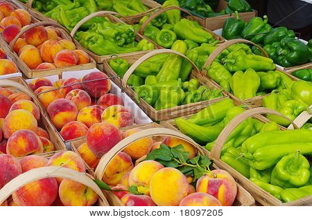 Peppers and Peaches on Display at a Farmer's Market