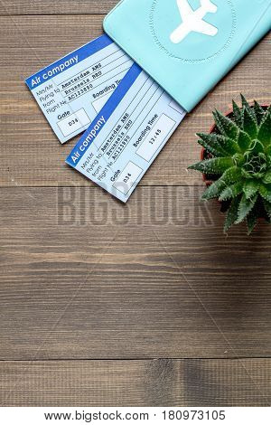 tourist stuff with passport and flight tickets on wooden table background top view mockup