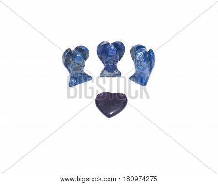 Amethyst heart and three lapis lazuli angels isolated on white background