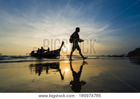 Ao Nang Krabi Thailand - March 03 2017: People on the Ao Nang beach at sunset in Krabi province Thailand