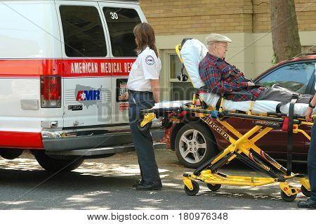 MAY 28, 2005. SEATTLE, WA.  CIRCA:  Male senior with chest pains being transported to the hospital.