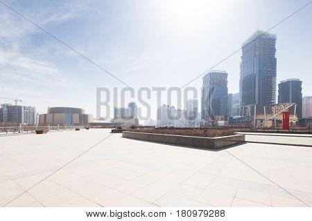 empty brick floor with cityscape of modern city