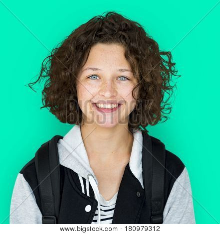 Young teenager girl is smiling