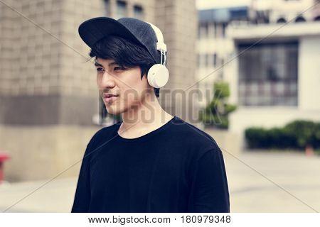 Asian Guy Listen to Music Headphones