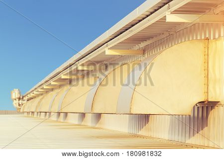 Air duct or hood for air conditioner system of factory building with blue sky background.
