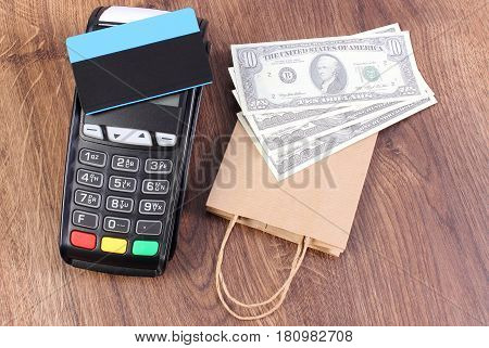 Payment Terminal With Credit Card, Currencies Dollar And Paper Shopping Bag, Paying For Shopping Con