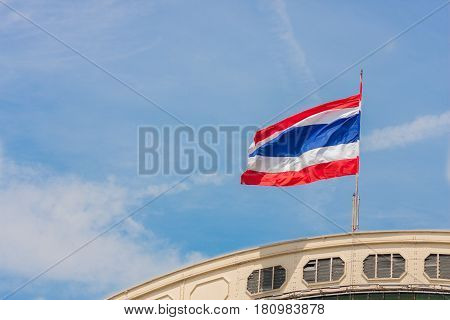 Waving Thailand flag on the railway station and blue sky