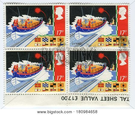 GOMEL, BELARUS, APRIL 9, 2017. Stamp printed in UK shows image of  The International maritime signal flags refers to various flags used to communicate with ships.