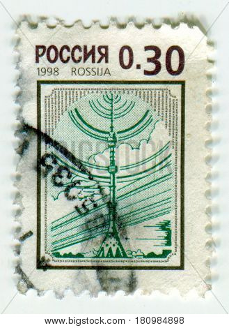 GOMEL, BELARUS, APRIL 8, 2017. Stamp printed in Russia shows image of  The Ostankino Tower is a television and radio tower in Moscow, Russia, circa 1998.