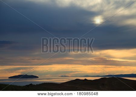 Small island on sunrise background, dramatic cloudscape or background