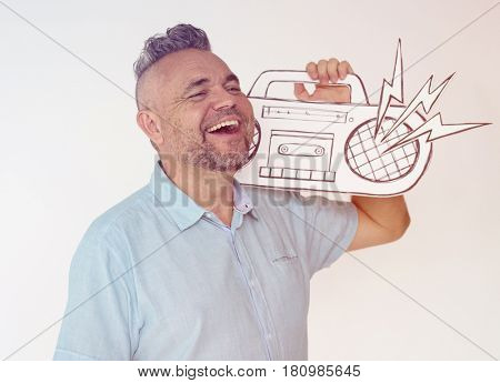 Senior man holding papercraft stereo media on white background