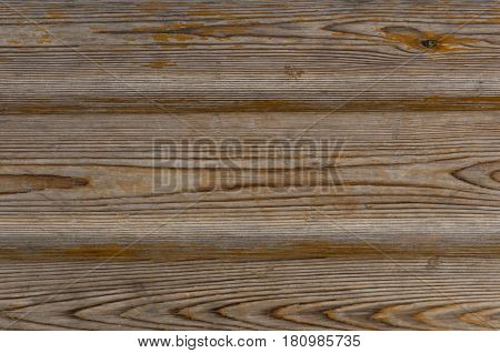 wooden boards with partially flown paint of orange color