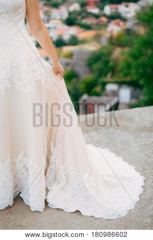 Touches the dress. The bride waving her dress. Fluttering dress of the bride. Wedding in Montenegro.
