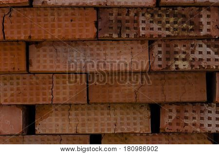wall of a red porous brick close up abstract background