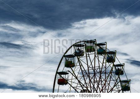 part of a big wheel with boxes against the background of the dark evening sky