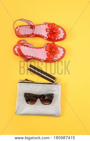 handbag and glasses,red shoes on a white background