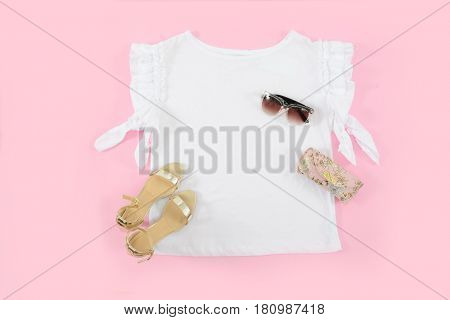 female shoes with white shirt,sunglasses and bag-pink background