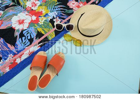 Fashion. Summer woman accessories-Summer floral scarf, shoes,hat, sunglasses,on blue background