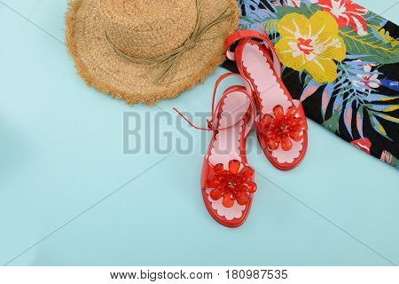 Fashion. Summer woman accessories-Summer floral scarf, shoes,hat on blue background
