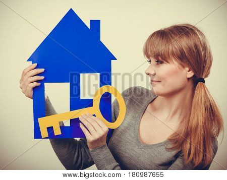 Selling and buying real estate concept. Young blonde smiling positive female estate agent ready to sell house home.