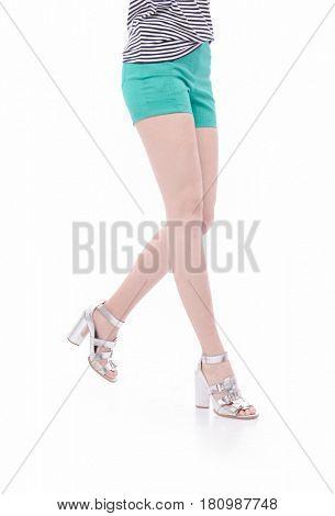 long sexy legs wearing short shorts-white background