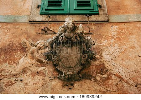 Classic outdoor bas-relief. Ancient statue on the walls of the old town of Kotor, in Montenegro