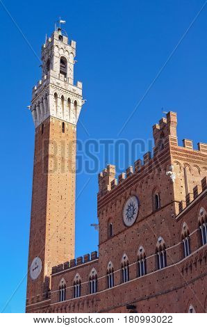 Torre del Mangia and the Palazzo Pubblico on the Piazza del Campo in Siena, Italy