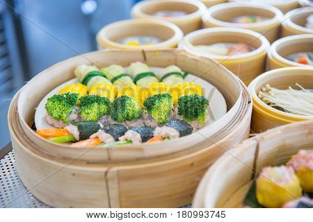Vegetable Yumcha Or Dim Sum, Chinese Cuisine Style Steam Food Served In Bamboo Stack Dish.