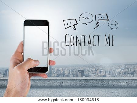 Digital composite of Hand holding phone and Contact Me text with drawings graphics