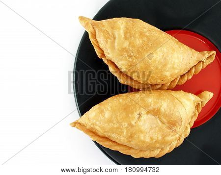 empanada - Argentine fried meat pies on plate isolated on white background, Asia called samosas or curry puff, closeup top view