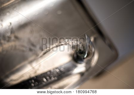 water fountain with stream of water from faucet