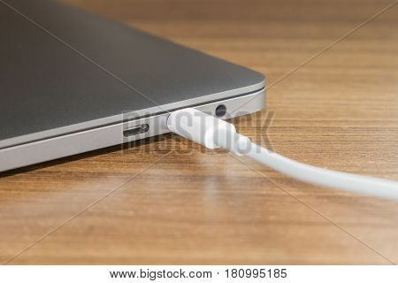 USB type-C port and Cable's White of laptop