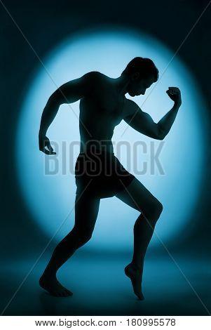 Silhouette of the bodybuilder
