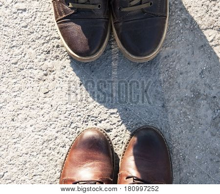 Brown leather boots stand on the ground,Brown boots
