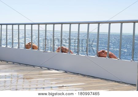 Deck on the stern of the yacht on a bright sunny day and beautiful blue sea water.