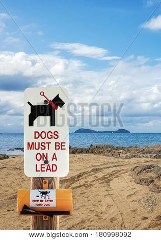 dogs must be on a lead on the beach and pick up after your dog sign