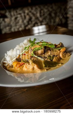 Thai chicken with vegetables and spice curry and rice