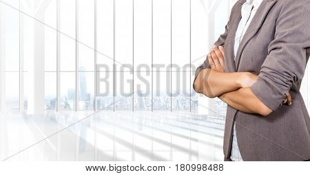 Digital composite of Business woman with blazer and her hands folded in the office