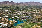 Over Scottsdale Arizona looking to the southwest at golf courses resorts luxury homes and Mummy Mountain poster