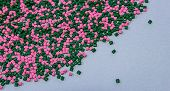 Polymeric dye. Plastic pellets. Colorant for plastics. Pigment in the granules.  Polymer beads poster
